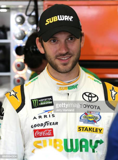 Daniel Suarez driver of the Subway Toyota stands in the garage during practice for the Monster Energy NASCAR Series CocaCola 600 at Charlotte Motor...