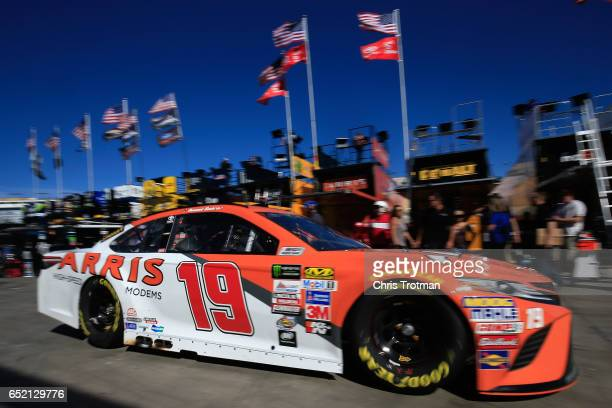 Daniel Suarez drives the ARRIS Toyota through the garage area during practice for the Monster Energy NASCAR Cup Series Kobalt 400 at Las Vegas Motor...