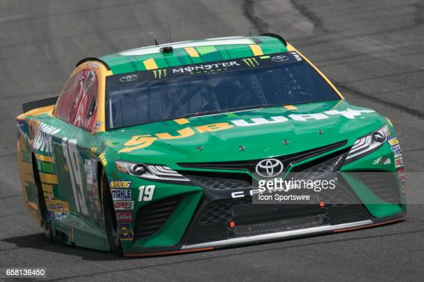 Daniel Suarez goes around turn 3 during the Monster Energy Cup Series 20th Anniversary Auto Club 400 at Auto Club Speedway in Fontana California on...