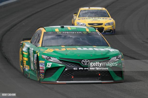 Daniel Suarez goes around turn 4 during the Monster Energy Cup Series 20th Anniversary Auto Club 400 at Auto Club Speedway in Fontana California on...