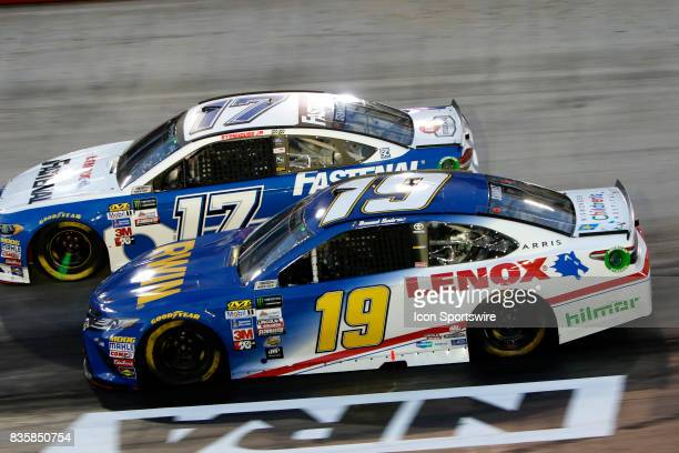 Daniel Suarez Joe Gibbs Racing Irwin/Lenox Toyota Camry and Ricky Stenhouse jr during the running of the 57th annual Bass Pro Shops NRA Night Race...
