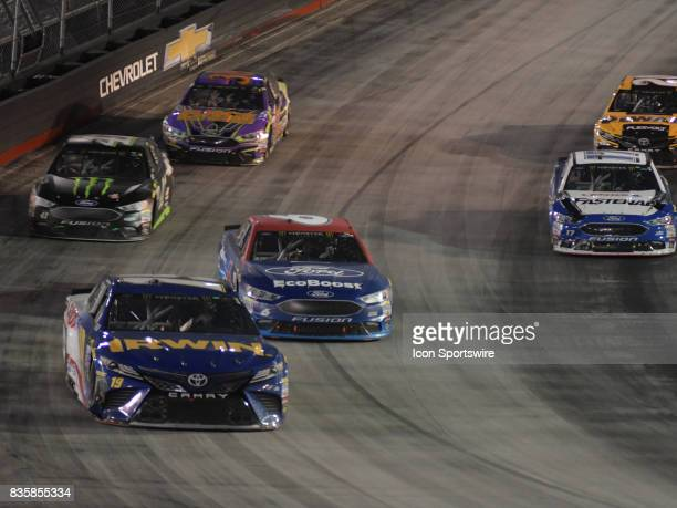 Daniel Suarez Joe Gibbs Racing Irwin/Lenox Toyota Camry and Trevor Bayne Roush/Fenway Racing Ford EcoBoost Ford Fusion race through the turns during...