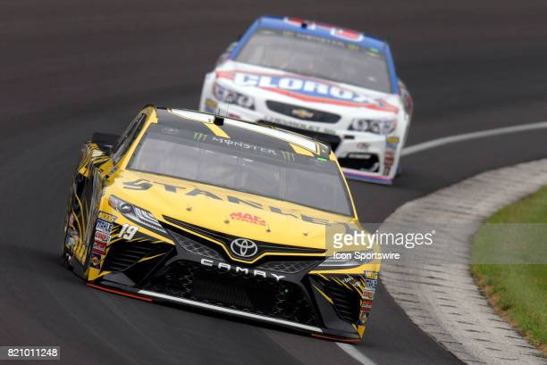 Daniel Suarez Joe Gibbs Racing Toyota Camry and AJ Allmendinger JTGDaugherty Racing Chevrolet SS make their way through turn one during practice for...