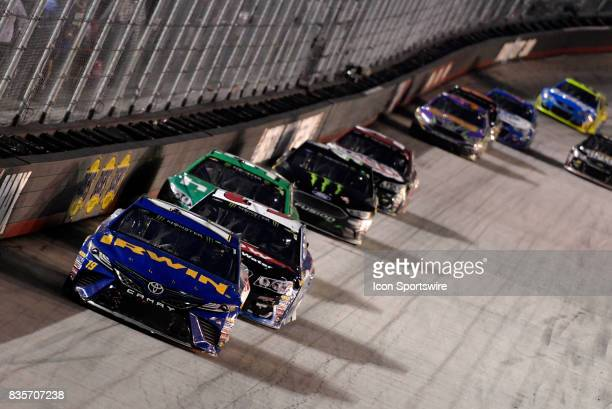 Daniel Suarez Joe Gibbs Racing Toyota Camry leads a pack of cars down the back stretch during the Bass Pro Shops NRA Night Race on August 19 at the...