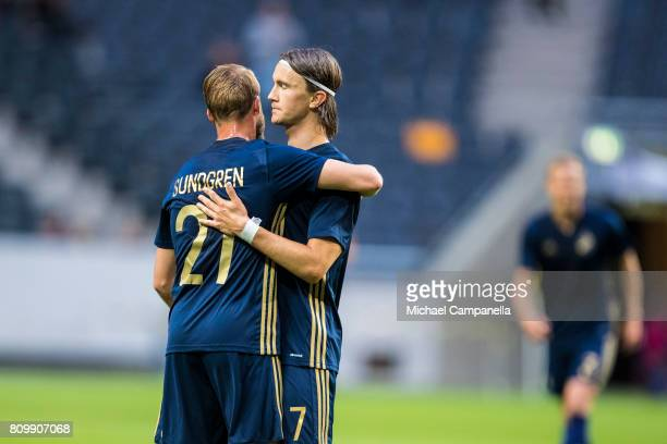 Daniel Sundgren embraces with Kristoffer Olsson after he scores the 40 goal during a UEFA Europe League qualification match at Friends arena on July...