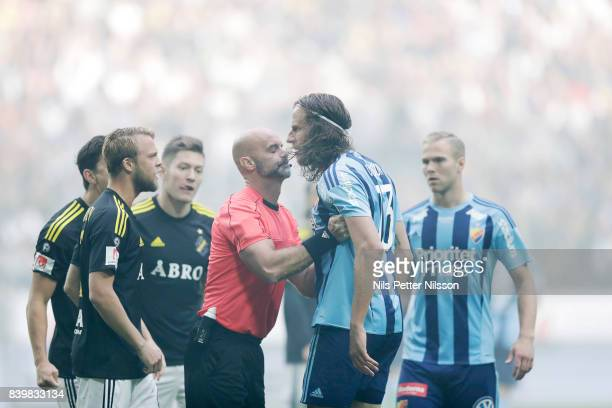 Daniel Sundgren of AIK and Jonas Olsson of Djurgardens IF in an argument during the Allsvenskan match between AIK and Djurgardens IF at Friends arena...