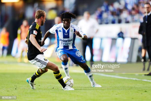 Daniel Sundgren of AIK and Sam Adekugbe of IFK Goteborg competes for the ball during the Allsvenskan match between IFK Goteborg and AIK at Gamla...