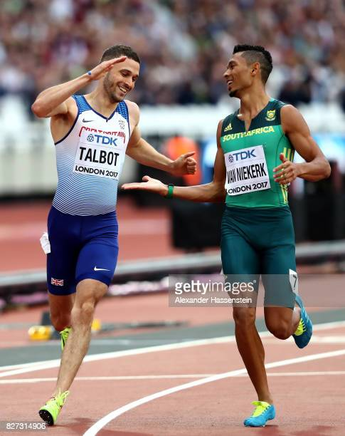 Daniel Talbot of Great Britain and Wayde van Niekerk of South Africa react after competing in the Men's 200 metres heats during day four of the 16th...