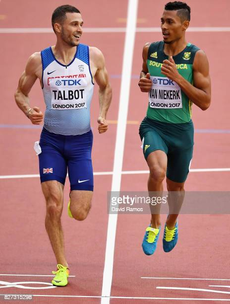 Daniel Talbot of Great Britain and Wayde van Niekerk of South Africa compete in the Men's 200 metres heats during day four of the 16th IAAF World...