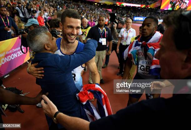 Daniel Talbot of Great Britain celebrates with the mayor of London Sadiq Khan after winning gold in the Men's 4x100 Relay final during day nine of...