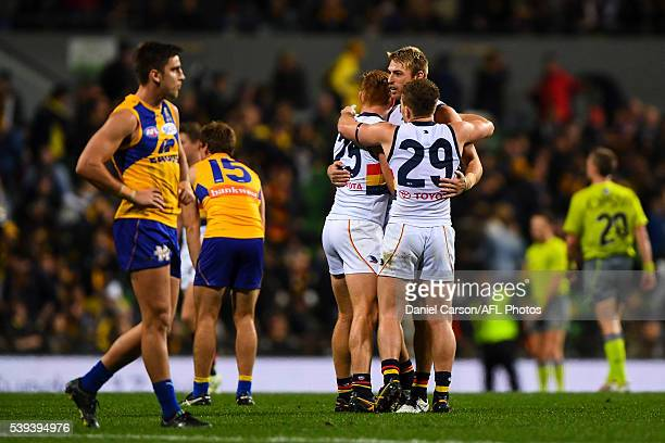 Daniel Talia Kyle Cheney and Rory Laird of the Crows celebrate the win during the 2016 AFL Round 12 match between the West Coast Eagles and the...