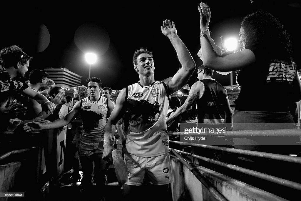 Daniel Talia of the Crows celebrates winning the round two AFL match between the Brisbane Lions and the Adelaide Crows at The Gabba on April 6, 2013 in Brisbane, Australia.