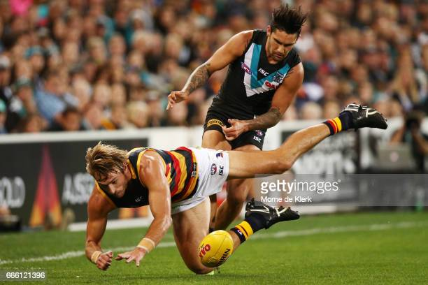 Daniel Talia of the Crows is tackled by Chad Wingard of the Power during the round three AFL match between the Port Adelaide Power and the Adelaide...