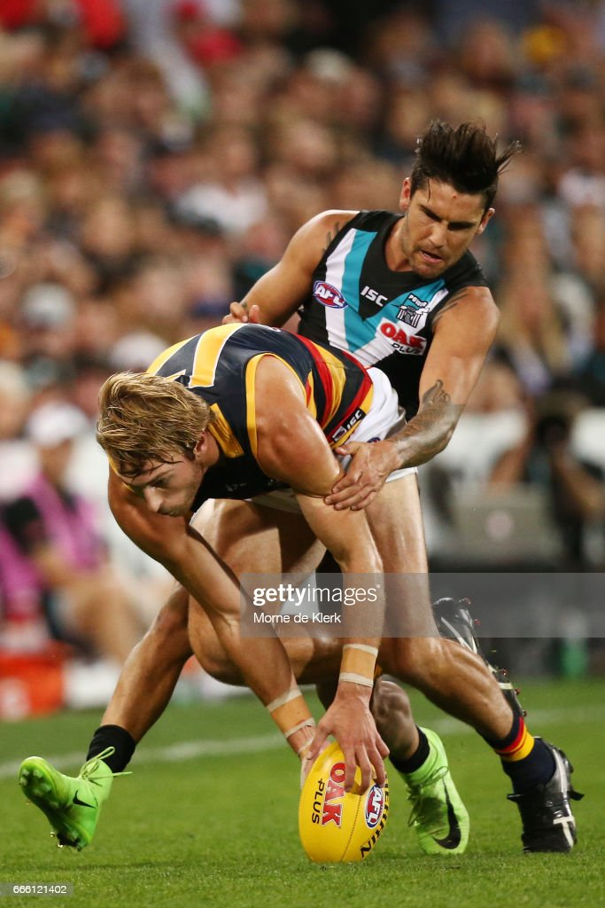 Daniel Talia of the Crows is tackled by Chad Wingard of the Power during the round three AFL match between the Port Adelaide Power and the Adelaide Crows at Adelaide Oval on April 8, 2017 in Adelaide, Australia.