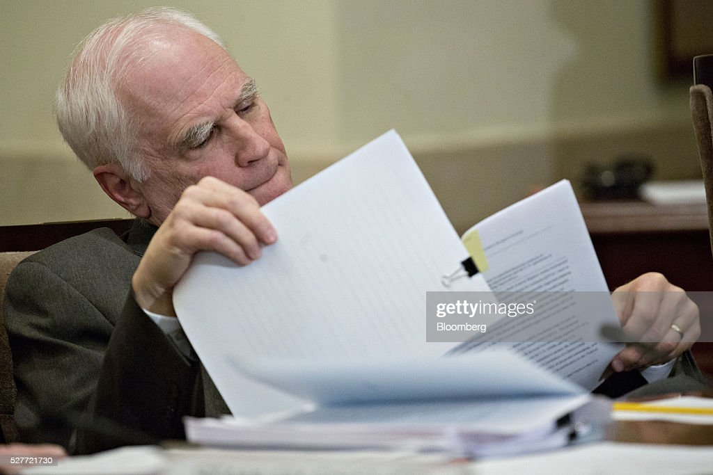 Daniel Tarullo, governor of the U.S. Federal Reserve, looks through documents during a meeting of the Board of Governors of the Federal Reserve in Washington, D.C., U.S., on Tuesday, May 3, 2016. Hedge funds, insurers and other companies that do business with Wall Street megabanks are poised to pay a price for regulators' efforts to make sure any future collapse of a giant lender doesn't tank the entire financial system. Photographer: Andrew Harrer/Bloomberg via Getty Images