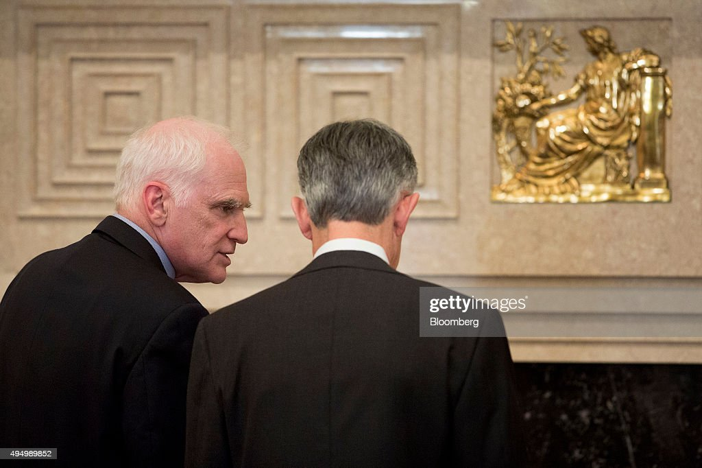 Daniel Tarullo, left, and Jerome Powell, governors of the U.S. Federal Reserve, talk before the start of a meeting of the Board of Governors of the Federal Reserve in Washington, D.C., U.S., on Friday, Oct. 30, 2015. According to a Federal Reserve rule that's set to be approved today, the largest U.S. banks would face a $120 billion total shortfall of long-term debt under a Fed proposal aimed at ensuring their failure wouldn't hurt the broader financial system. Photographer: Andrew Harrer/Bloomberg via Getty Images