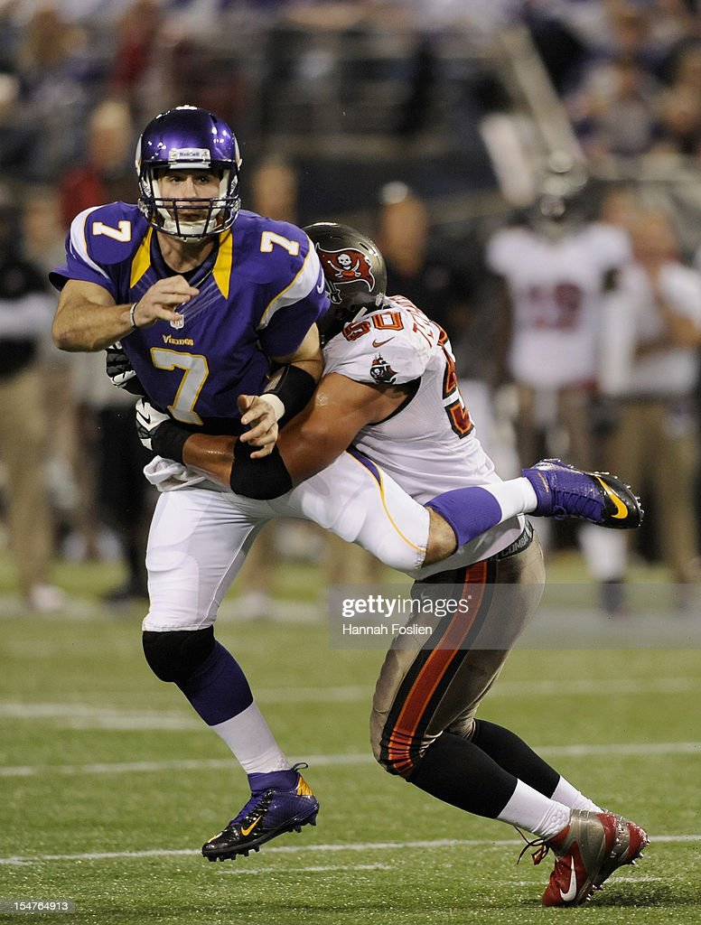 Daniel Te'o-Nesheim #50 of the Tampa Bay Buccaneers hits <a gi-track='captionPersonalityLinkClicked' href=/galleries/search?phrase=Christian+Ponder&family=editorial&specificpeople=4505733 ng-click='$event.stopPropagation()'>Christian Ponder</a> #7 of the Minnesota Vikings after a pass during the fourth quarter of the game on October 25, 2012 at Mall of America Field at the Hubert H. Humphrey Metrodome in Minneapolis, Minnesota. The Buccaneers defeated the Vikings 36-17.