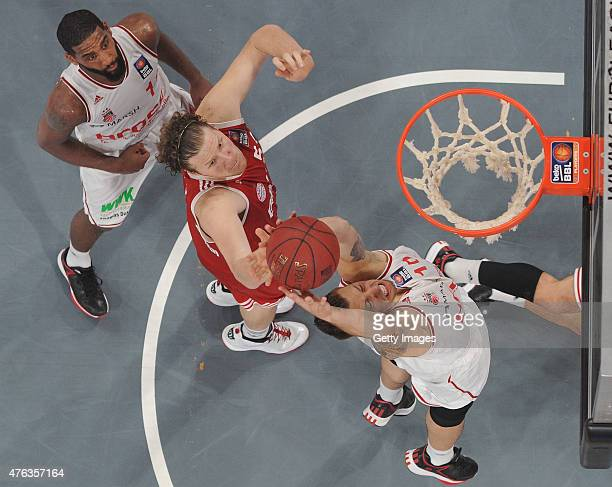 Daniel Theis of Brose Baskets Bamberg catches the rebounding ball against #John Bryant of FC Bayern Muenchen during Game One of the 2015 BBL Finals...