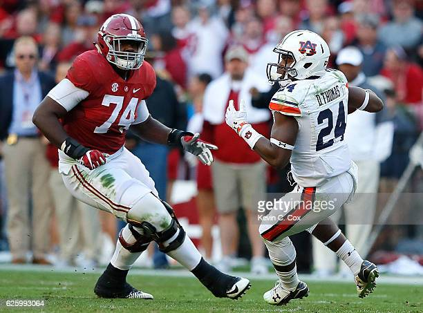 Daniel Thomas of the Auburn Tigers attempts to return an interception against Cam Robinson of the Alabama Crimson Tide at BryantDenny Stadium on...