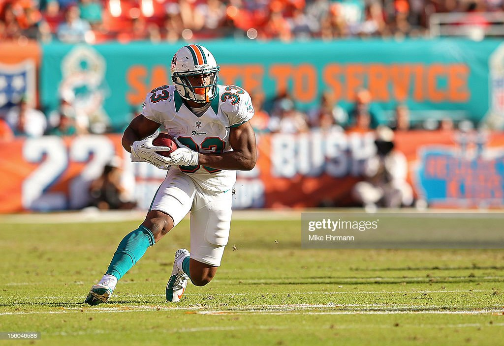Daniel Thomas #33 of the Miami Dolphins rushes during a game against the Tennessee Titans at Sun Life Stadium on November 11, 2012 in Miami Gardens, Florida.