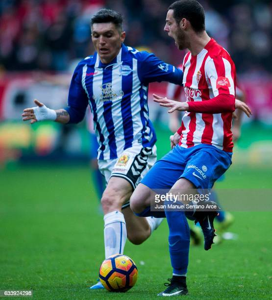 Daniel Torres of Deportivo Alaves duels for the ball with Jorge Franco 'Burgui' of Real Sporting de Gijon during the La Liga match between Real...