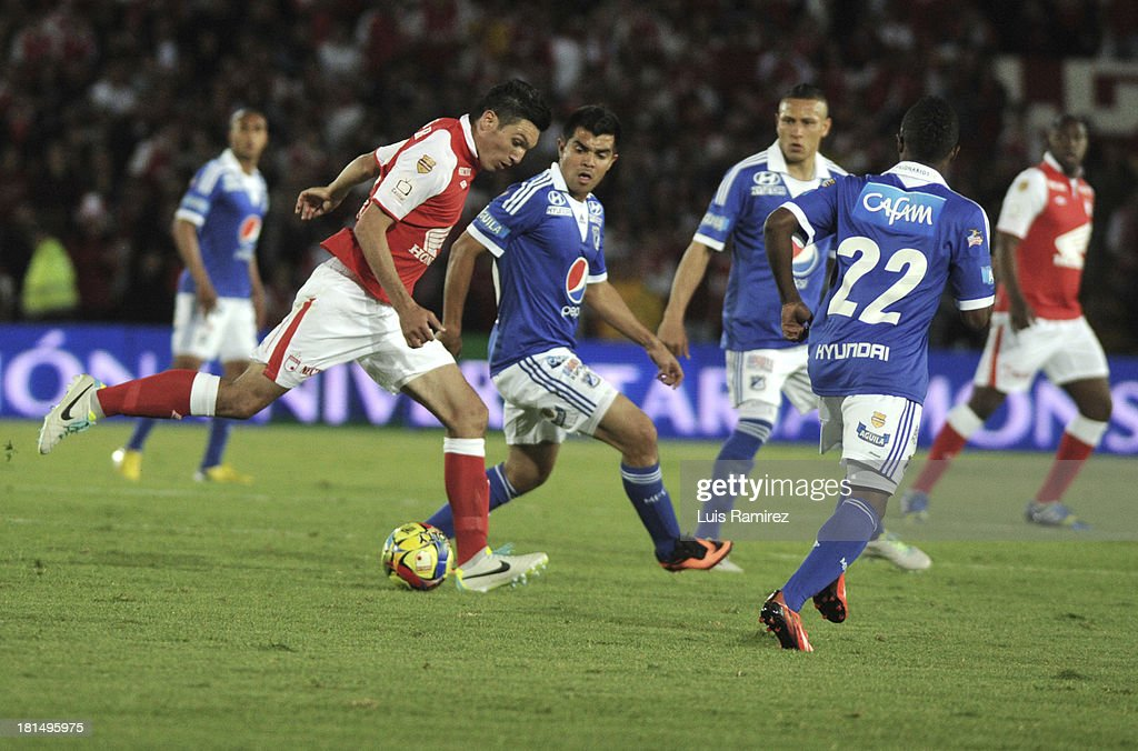Daniel Torres of Independiente Santa Fe fights for the ball with Harrison Otalvaro, Yuber Asprilla and Anderson Zapata of Millonarios during a match between Independiente Santa Fe and Millonarios as part of the Liga Postobon II at Nemesio Camacho Stadium on September 21, 2013 in Bogota, Colombia.