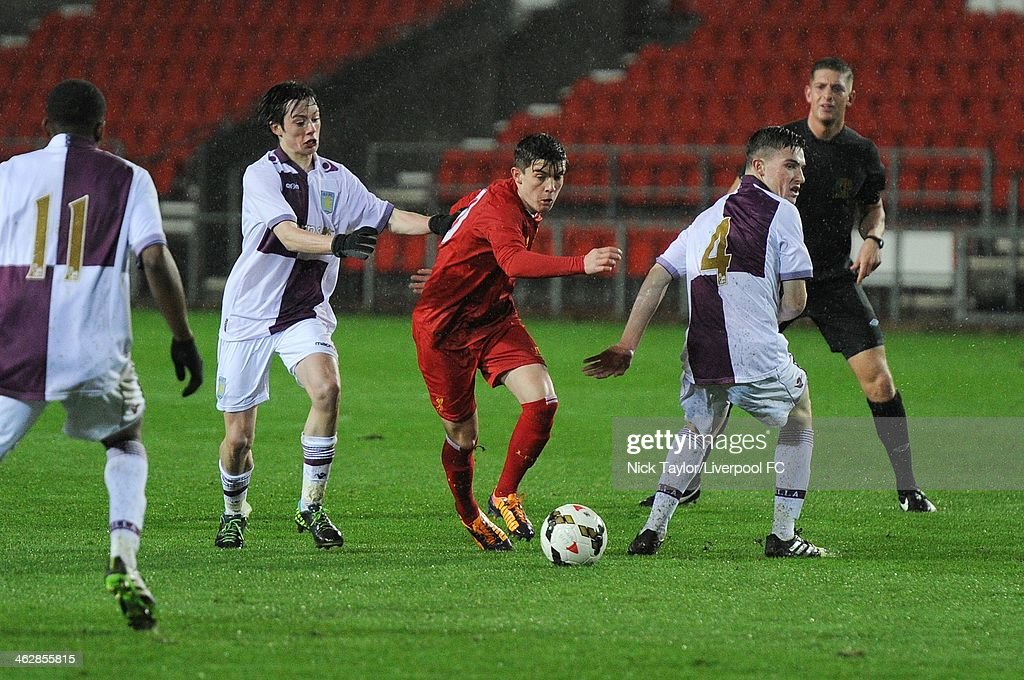 Daniel Trickett-Smith of Liverpool evades Harry McKirdy and Ryan Strain (4) of Aston Villa during the FA Youth Cup Fourth Round fixture between Liverpool and Aston Villa at Langtree Park on January 15, 2014 in St Helens, England.