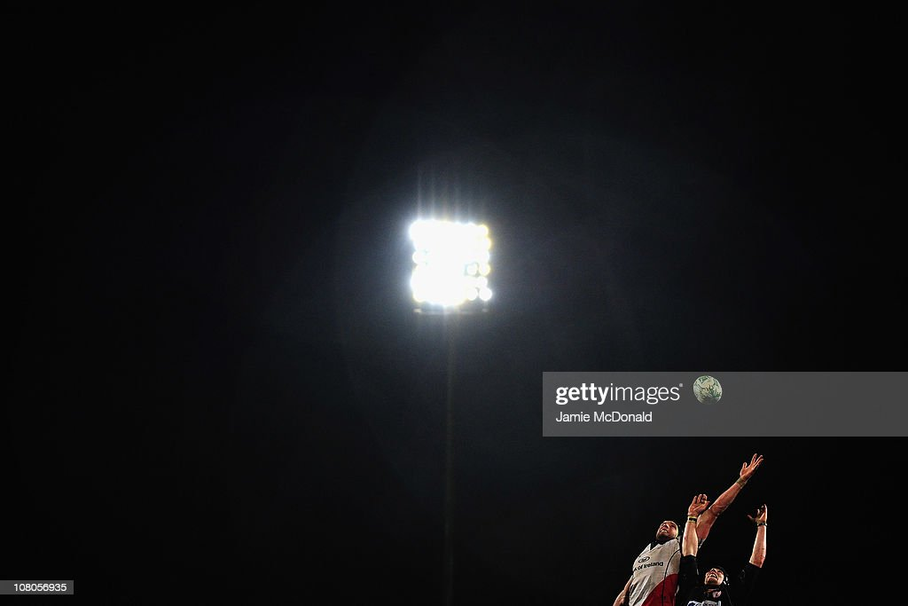 Daniel Tuohy of Ulster jumps jumps in the line out with Magnus Lund of Biarritz during the Heineken Cup match between Ulster and Biarritz at...