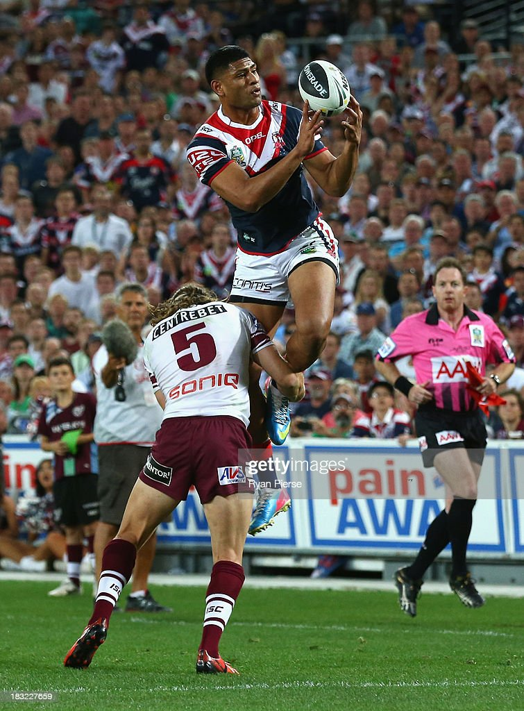 Daniel Tupou of the Roosters catches the ball before scoring a try during the 2013 NRL Grand Final match between the Sydney Roosters and the Manly Warringah Sea Eagles at ANZ Stadium on October 6, 2013 in Sydney, Australia.
