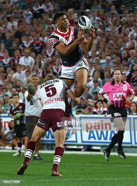 Daniel Tupou of the Roosters catches the ball before scoring a try during the 2013 NRL Grand Final match between the Sydney Roosters and the Manly...