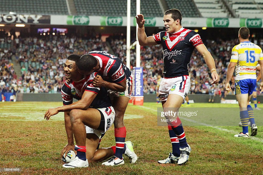 Daniel Tupou (L) of the Roosters celebrates with Michael Jennings (C) and Daniel Mortimer (R) after scoring a try during the round four NRL match between the Sydney Roosters and the Parramatta Eels at Allianz Stadium on April 1, 2013 in Sydney, Australia.