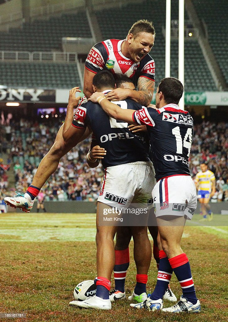 Daniel Tupou #2 of the Roosters celebrates with team mates after scoring a try as Jared Waerea-Hargreaves (top) jumps over the top during the round four NRL match between the Sydney Roosters and the Parramatta Eels at Allianz Stadium on April 1, 2013 in Sydney, Australia.
