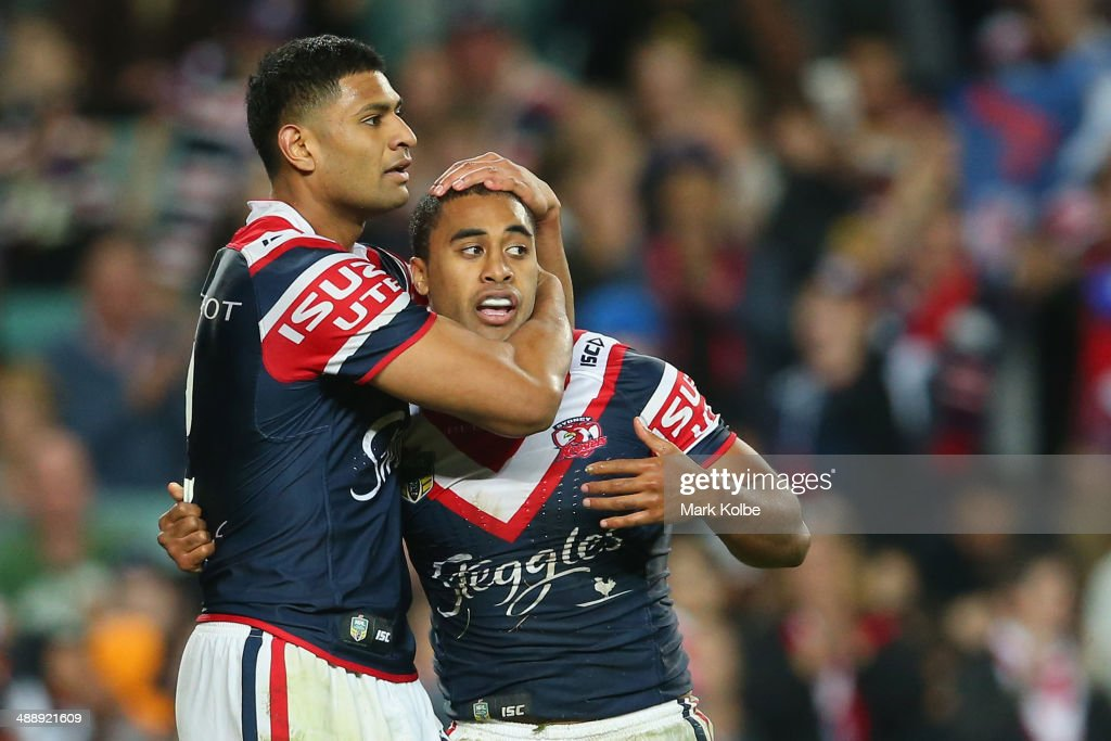 <a gi-track='captionPersonalityLinkClicked' href=/galleries/search?phrase=Daniel+Tupou&family=editorial&specificpeople=7828055 ng-click='$event.stopPropagation()'>Daniel Tupou</a> of the Roosters congratulates Michael Jennings of the Roosters as he celebrates scoring a try during the round nine NRL match between the Sydney Roosters and the Wests Tigers at Allianz Stadium on May 9, 2014 in Sydney, Australia.