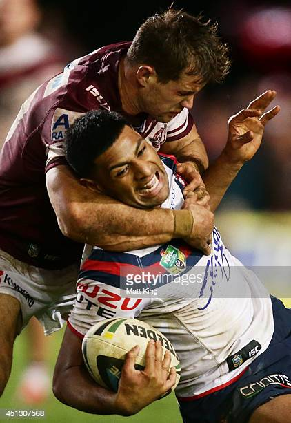 Daniel Tupou of the Roosters is tackled by Brenton Lawrence of the Sea Eagles during the round 16 NRL match between the Manly Warringah Sea Eagles...