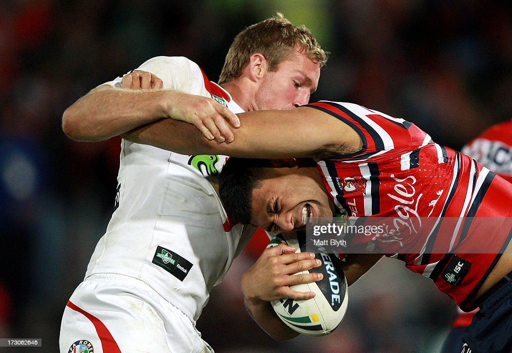 Daniel Tupou of the Roosters is tackled by Matt Prior of the Dragons during the round 17 NRL match between the St George Illawarra Dragons and the Sydney Roosters at WIN Jubilee Stadium on July 6, 2013 in Sydney, Australia.