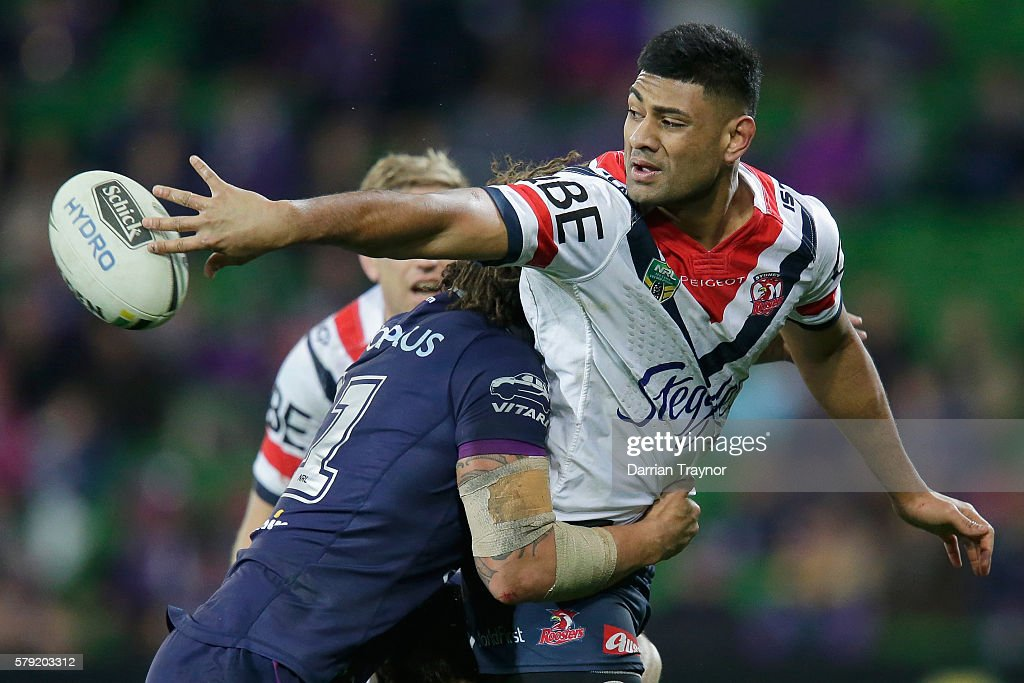 Daniel Tupou of the Roosters passes the ball during the round 20 NRL match between the Melbourne Storm and the Sydney Roosters at AAMI Park on July 23, 2016 in Melbourne, Australia.