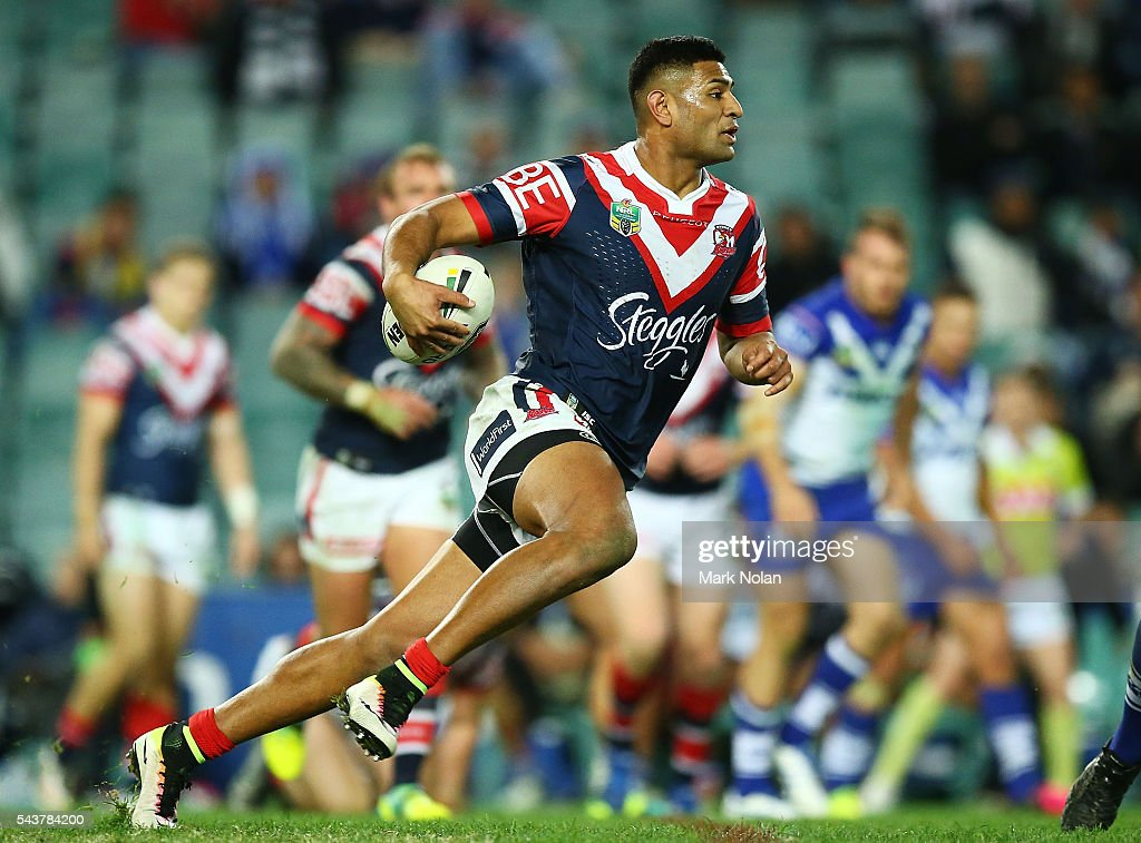 <a gi-track='captionPersonalityLinkClicked' href=/galleries/search?phrase=Daniel+Tupou&family=editorial&specificpeople=7828055 ng-click='$event.stopPropagation()'>Daniel Tupou</a> of the Roosters runs the ball during the round 17 NRL match between the Sydney Roosters and the Canterbury Bulldogs at Allianz Stadium on June 30, 2016 in Sydney, Australia.