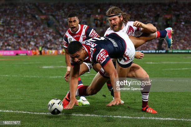 Daniel Tupou of the Roosters scores a try during the 2013 NRL Grand Final match between the Sydney Roosters and the Manly Warringah Sea Eagles at ANZ...