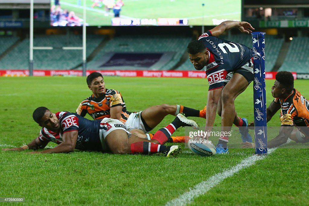 Daniel Tupou of the Roosters scores a try during the round nine NRL match between the Sydney Roosters and the Wests Tigers at Allianz Stadium on May 8, 2015 in Sydney, Australia.