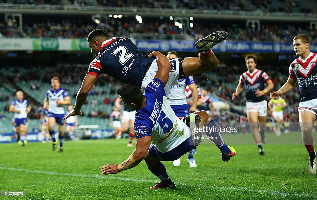 <a gi-track='captionPersonalityLinkClicked' href=/galleries/search?phrase=Daniel+Tupou&family=editorial&specificpeople=7828055 ng-click='$event.stopPropagation()'>Daniel Tupou</a> of the Roosters takes a high ball to score a try during the round 17 NRL match between the Sydney Roosters and the Canterbury Bulldogs at Allianz Stadium on June 30, 2016 in Sydney, Australia.