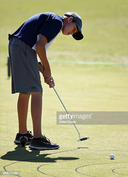 Daniel Uranga hits his putt during the putting segment in the Boys 1415 yr old Drive Chip and Putt regional qualifying at Chambers Bay on September...