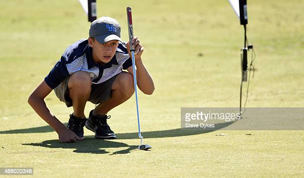 Daniel Uranga lines up his putt during the putting segment in the Boys 1415 yr old Drive Chip and Putt regional qualifying at Chambers Bay on...