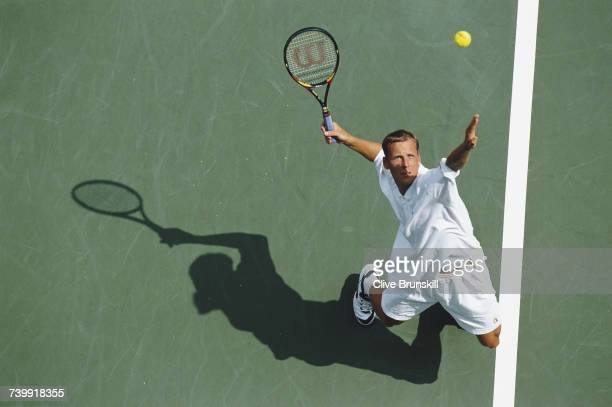 Daniel Vacek of the Czech Republic serves to Mark Philippoussis during their Men's Singles third round match at the US Open Tennis Championship on 31...