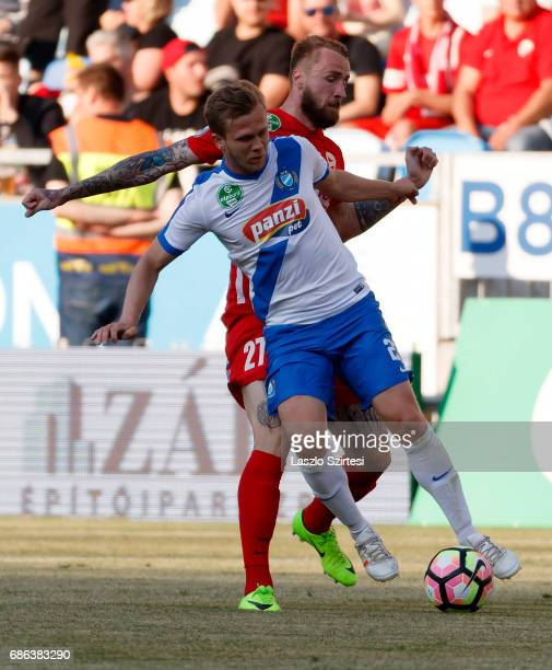 Daniel Vadnai of MTK Budapest battles for the ball with Akos Szarka of DVTK during the Hungarian OTP Bank Liga match between MTK Budapest and DVTK at...