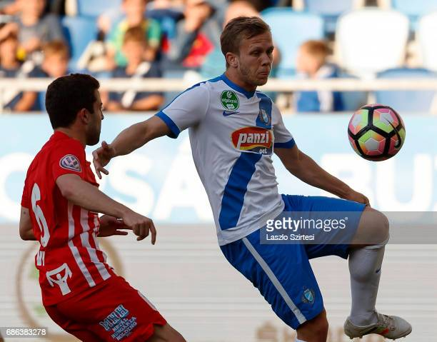 Daniel Vadnai of MTK Budapest wins the ball from Diego Vela of DVTK during the Hungarian OTP Bank Liga match between MTK Budapest and DVTK at Nandor...