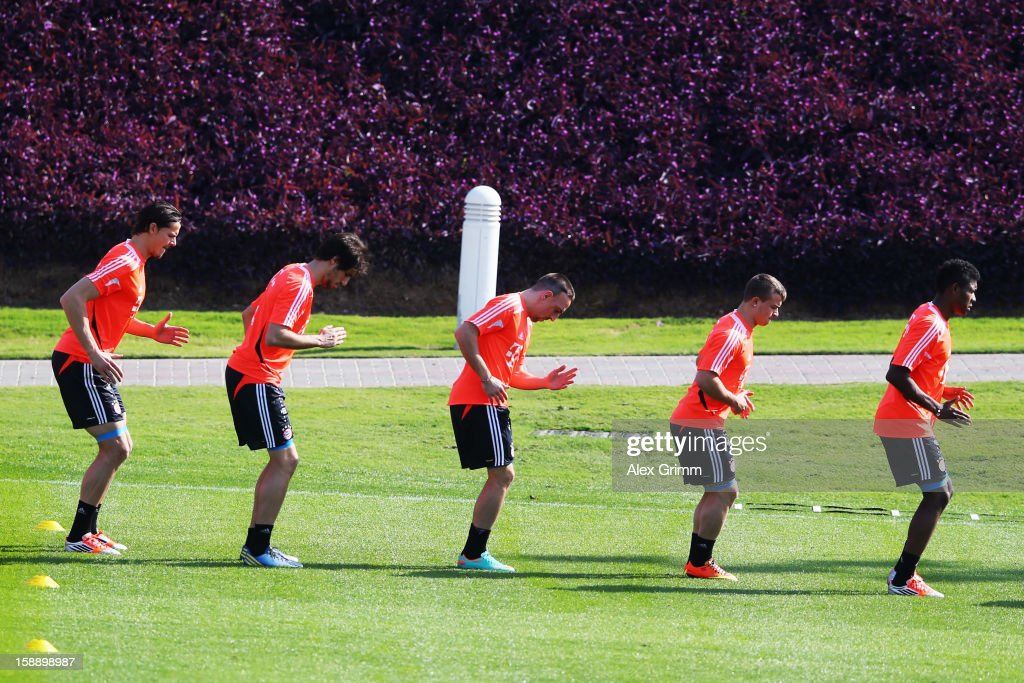 Daniel van Buyten, Javier Martinez, Franck Ribery, Xherdan Shaqiri and David Alaba (L-R) exercise during a Bayern Muenchen training session at the ASPIRE Academy for Sports Excellence on January 3, 2013 in Doha, Qatar.