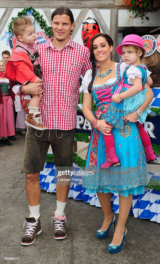 <a gi-track='captionPersonalityLinkClicked' href=/galleries/search?phrase=Daniel+van+Buyten&family=editorial&specificpeople=213252 ng-click='$event.stopPropagation()'>Daniel van Buyten</a> of Bayern Muenchen and his wife Celine attend the Oktoberfest 2013 beer festival at Kaefers Wiesenschaenke on October 6, 2013 in Munich, Germany.