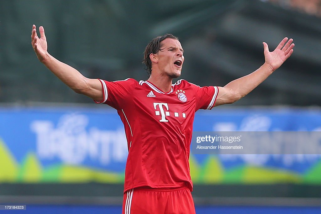 <a gi-track='captionPersonalityLinkClicked' href=/galleries/search?phrase=Daniel+van+Buyten&family=editorial&specificpeople=213252 ng-click='$event.stopPropagation()'>Daniel van Buyten</a> of Bayern Muenchen reacts during the friendly match between Brescia Calcio and FC Bayern Muenchen at Campo Sportivo on July 9, 2013 in Arco, Italy.
