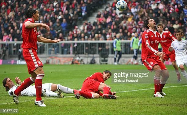 Daniel van Buyten of Bayern Muenchen scores the opening goal during the Bundesliga match between FC Bayern Muenchen and FC Schalke 04 at Allianz...