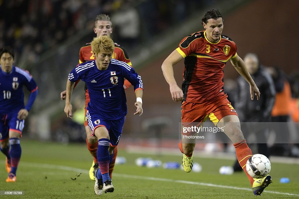 Daniel Van Buyten of Belgium battles for the ball with Kakitani Yoichiro of Japan during the pre World Cup international friendly match between Belgium and Japan on November 19, 2013 in Brussels, Belgium